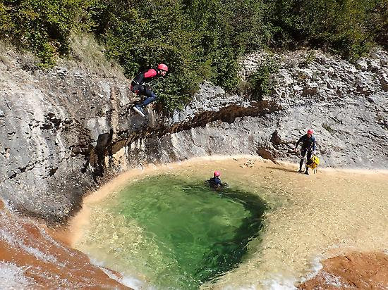 Jumping in a natural pool