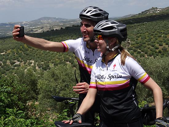 Selfie time, olive yards, happy cyclists