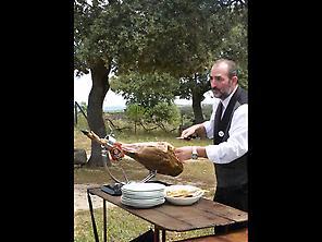 Master slicer carving Ibérico ham