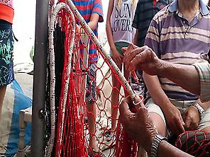 Repairing the fishing nets.