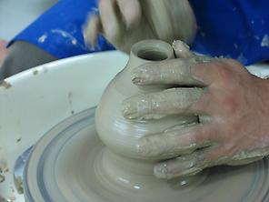 Craftsman makes a piece of ceramic.