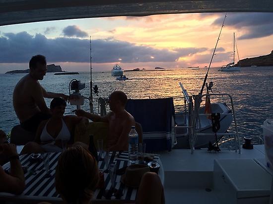 sunset on board our catamaran in benirra