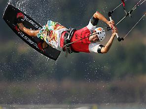 A man practising kitesurfing