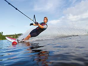A woman practising water-skiing