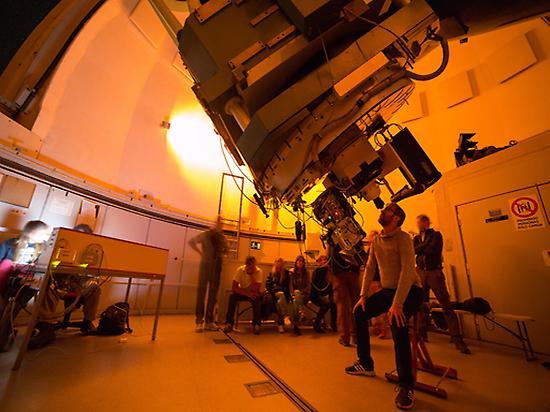 Look through a professional telescope