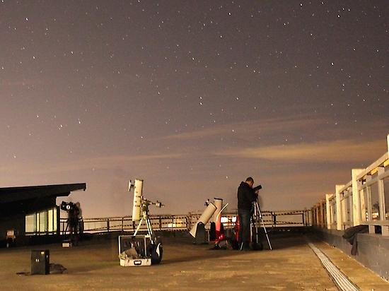 Observation of stars with telescopes.