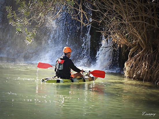 Kayak in waterfall
