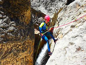 Kid abseiling in a canyon of Guara