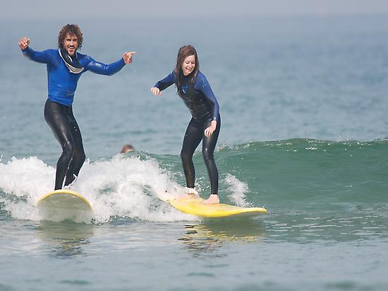 Enjoying the wave with an instructor