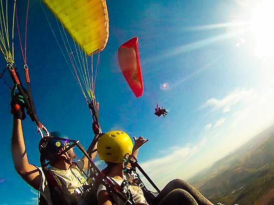 Tandem Paragliding Flight in Hig...