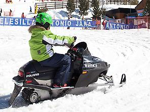 Children snowmobile Sierra Nevada