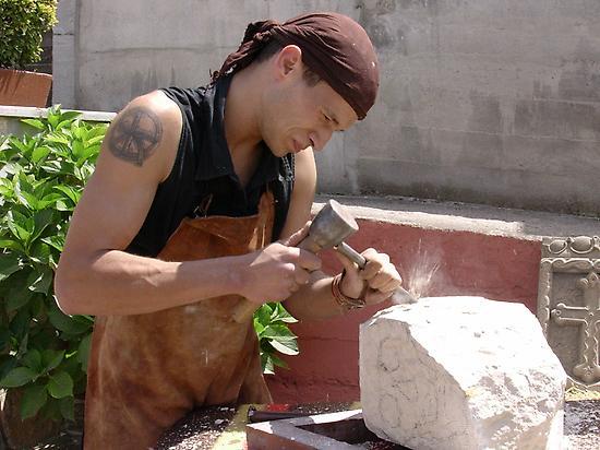 Craftsman working the stone